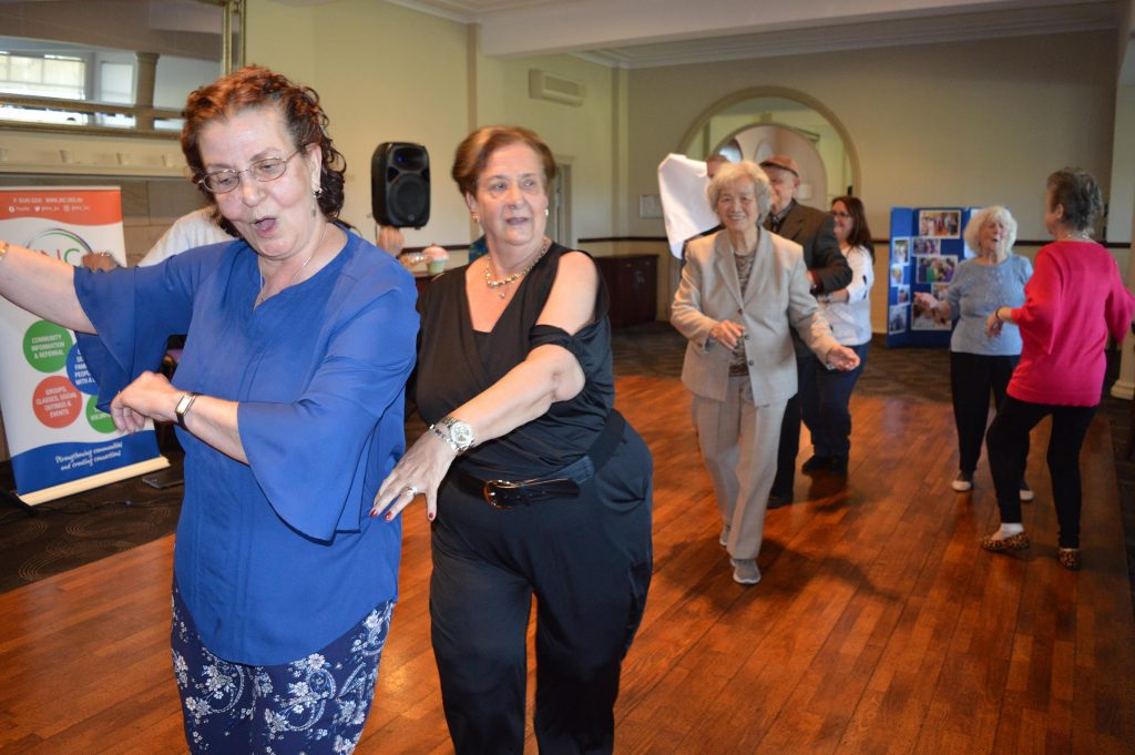 people dancing at JNC winter Lunch in June 2018
