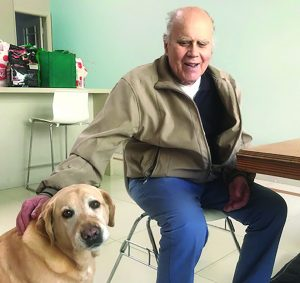 Photo of Theo and his dog Story 6 of JNC 45 years 45 stories