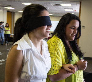 VAST delivers a bi-annual Learning & Development Calendar. Pictured is a Vision Impairment Activity conducted at a VAST Volunteer Orientation Course -
